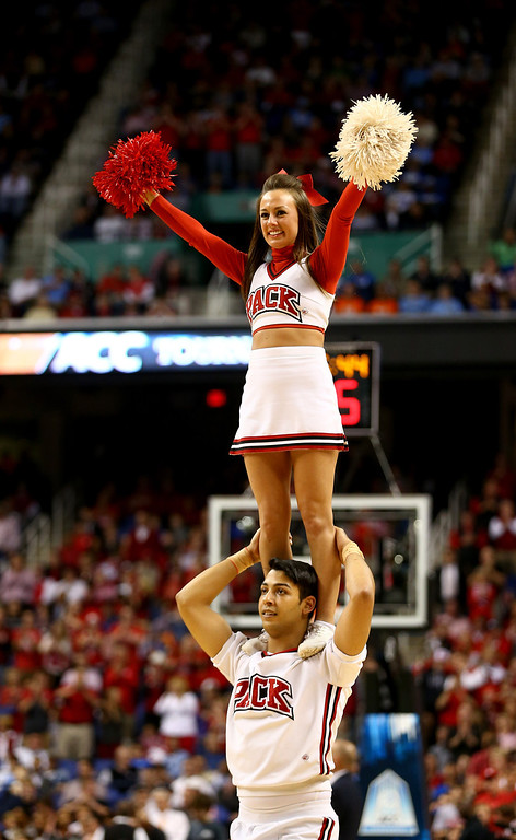 . The North Carolina State Wolfpack cheerleaders in action during the quarterfinals of the 2014 Men\'s ACC Basketball Tournament at Greensboro Coliseum on March 14, 2014 in Greensboro, North Carolina.  (Photo by Streeter Lecka/Getty Images)