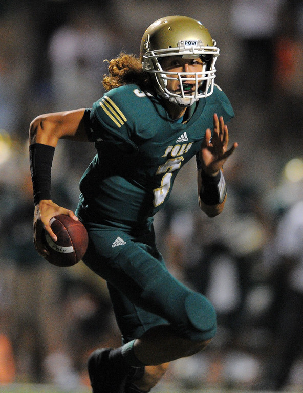 . Long Beach Poly football takes on Centennial (Corona) as part of the Mission Viejo Classic in Mission Viejo, CA on Friday, September 13, 2013. Long Beach Poly won 35-28.  Poly QB Tai Tiedemann rolls out on a run in the 4th qtr. (Photo by Scott Varley, Press-Telegram)