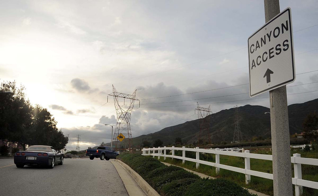 . A canyon access sign is posted near Skyline Drive Thursday March 7, 2013 in Rancho Cucamonga. A sign at the gate brings attention to the risks involved and recent fatalities at scenic falls area inside the canyon.  (Staff photo/Inland Valley Daily Bulletin)