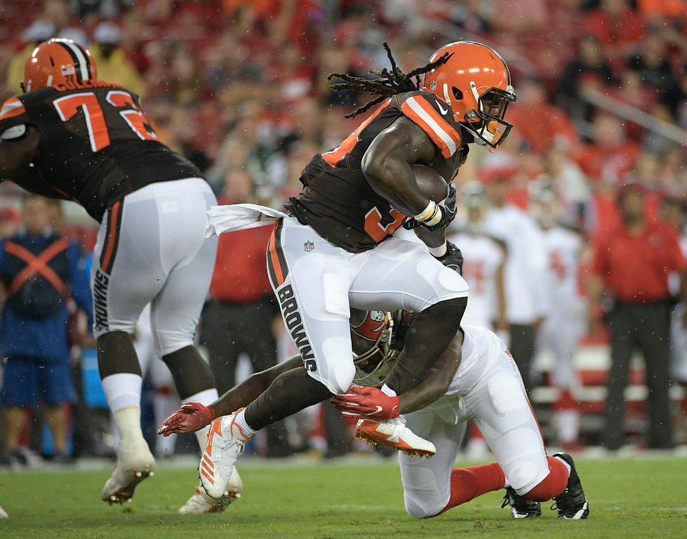 . Cleveland Browns running back Isaiah Crowell (34) is hit by Tampa Bay Buccaneers strong safety Keith Tandy during the first quarter of an NFL preseason football game Saturday, Aug. 26, 2017, in Tampa, Fla. (AP Photo/Phelan Ebenhack)