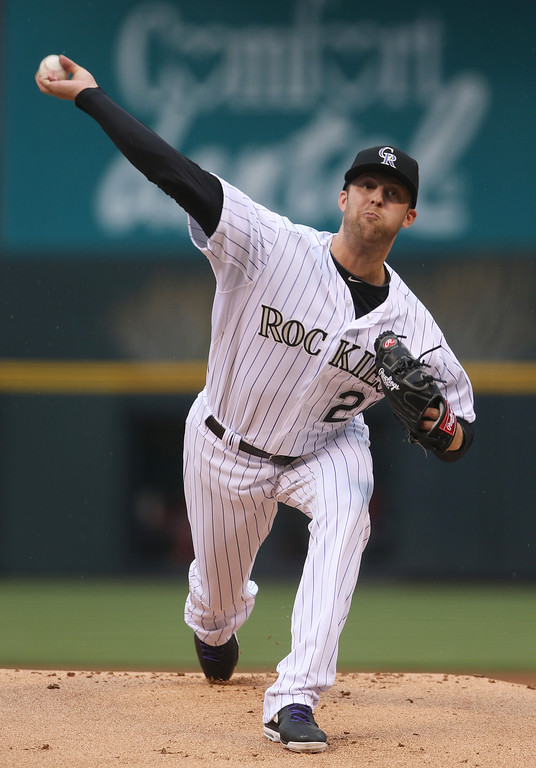 . Colorado Rockies starting pitcher Jordan Lyles delivers pitch against the Philadelphia Phillies in the first inning of a baseball game in Denver on Saturday, April 19, 2014. (AP Photo/David Zalubowski)