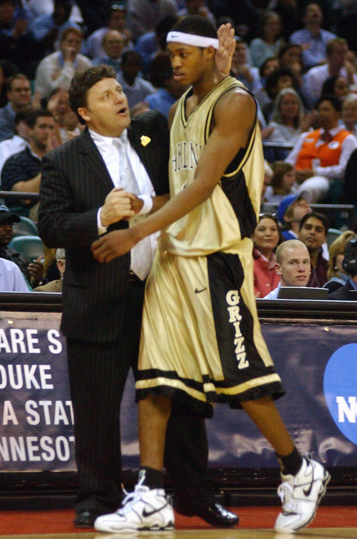 . Oakland University men\'s basketball head coach Greg Kampe, left, congratulates Rawle Marshall for his efforts as Marshall is taken out of the game during the final minutes of their game against North Carolina during first half action, Friday, March 18, 2005, at the Charlotte Coliseum in Charlotte, NC.  Oakland lost to North Carolina, 96-68.