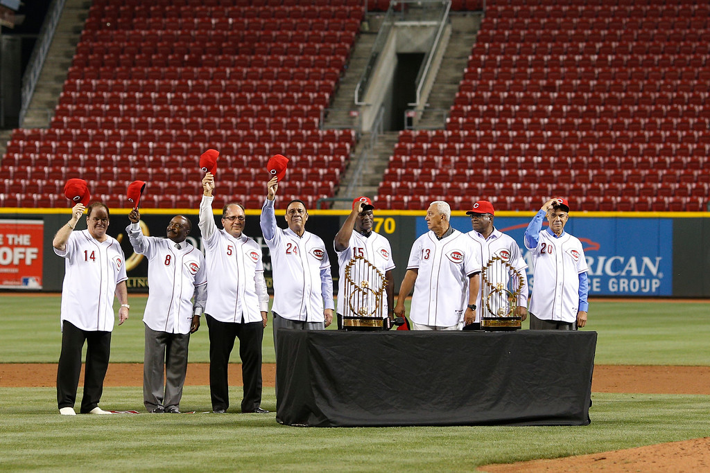 . CINCINNATI, OH - SEPTEMBER 6: Hall of fame second baseman Joe Morgan (2L) acknowledges the crowd along with former members of the Big Red Machine teams of the 1970s in a ceremony following the game between the Cincinnati Reds and Los Angeles Dodgers at Great American Ball Park on September 6, 2013 in Cincinnati, Ohio. The Reds won 3-2. (Photo by Joe Robbins/Getty Images)