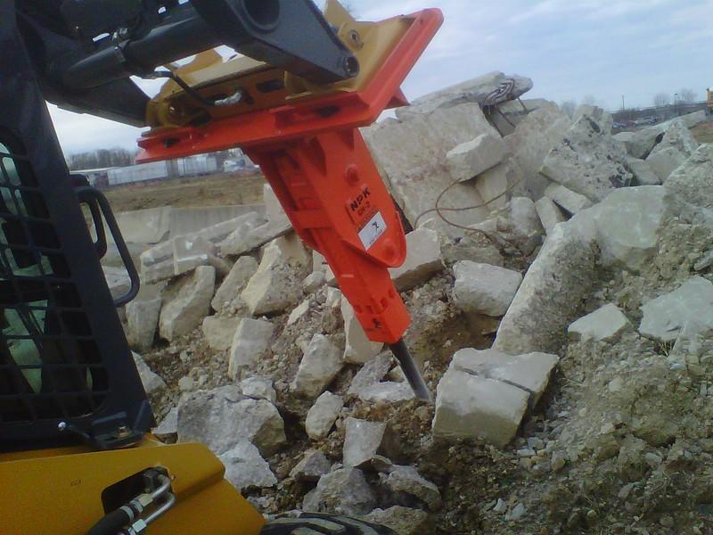 NPK GH2 hydraulic hammer on Deere 326D skidsteer (1).jpg