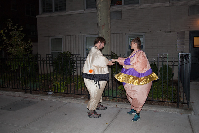 The man is trying to fixe his ballerina's  costume with duct tape. Seen near the Washington Square.