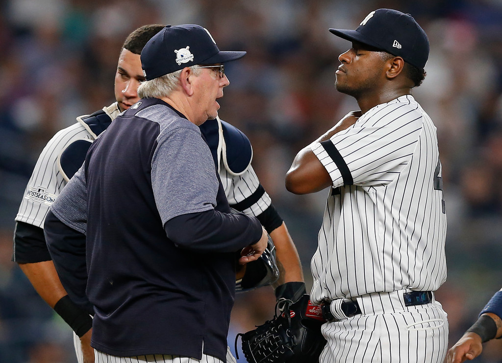 . New York Yankees pitcher Luis Severino, right, talks with pitching coach Larry Rothschild after giving up a two-run home run against the Cleveland Indians during the fourth inning in Game 4 of baseball\'s American League Division Series, Monday, Oct. 9, 2017, in New York. (AP Photo/Kathy Willens)