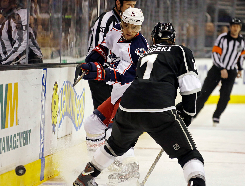 . Columbus Blue Jackets right wing Marian Gaborik (10) and Los Angeles Kings defenseman Rob Scuderi (7) battle in the first period of an NHL hockey game in Los Angeles, Thursday, April 18, 2013. (AP Photo/Reed Saxon)