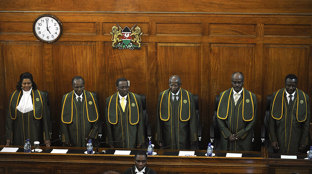 . Kenya Supreme court\'s six-judge bench led by Willy Mutunga (3rd L), Kenya\'s Chief Justice prepares to deliver a ruling on March 30, 2013 in the capital Nairobi. Kenya\'s Supreme court today upheld the victory of Uhuru Kenyatta in the March 4 presidential election, Mutunga said, throwing out a bid by his rival Raila Odinga for a new poll that would have revived the spectre of violence. The court unanimously ruled that the election had been fair and credible and that Kenyatta and his running mate had been validly elected.  TONY KARUMBA/AFP/Getty Images