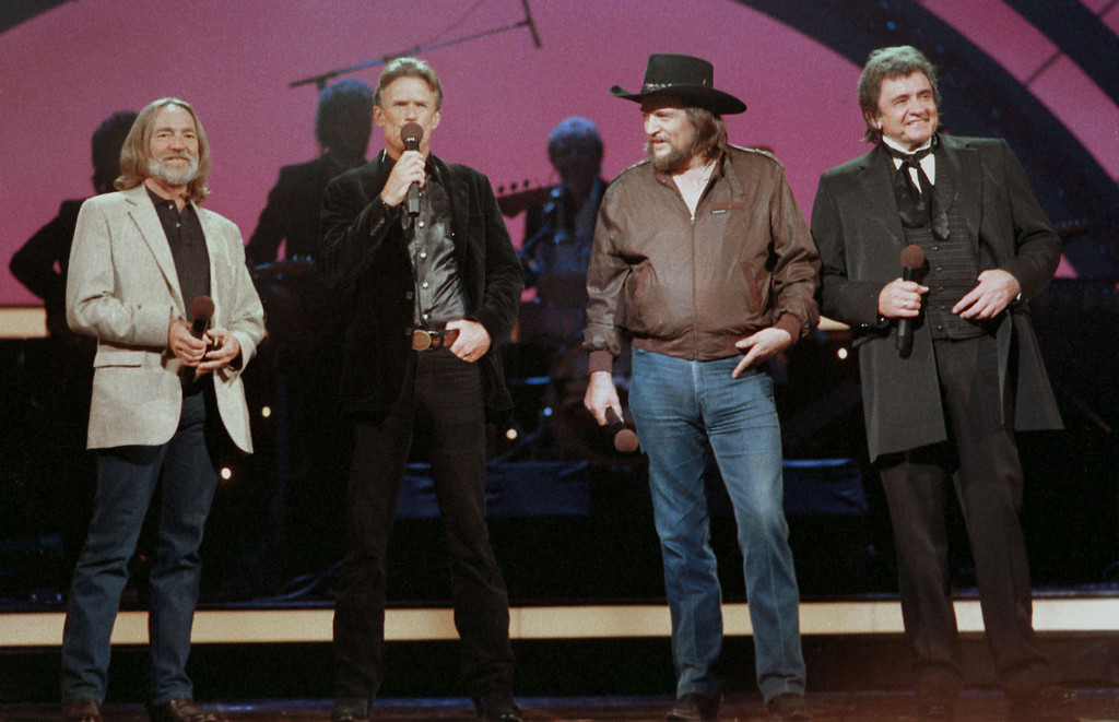 . Country music legend Johnny Cash, right, performs with the Highwaymen in October 1985 with Willie Nelson, left, Kris Kristofferson, second from left, and Waylon Jennings, second from right, in Nashville, Tenn.  (AP Photo/Mark Humphrey)