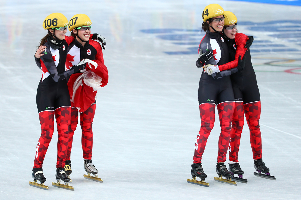 . Members of Canadian women\'s short track team celebrate winning the silver medal in the Short Track Ladies\' 3000m Relay Final at Iceberg Skating Palace on day 11 of the 2014 Sochi Winter Olympics on February 18, 2014 in Sochi, Russia.  (Photo by Streeter Lecka/Getty Images)