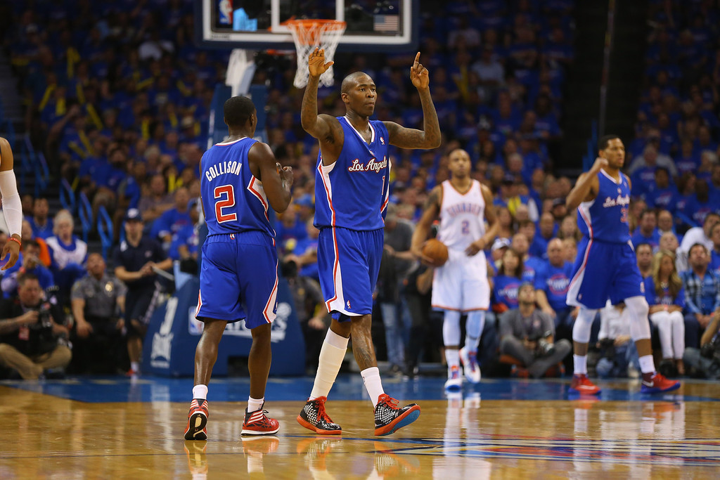 . Jamal Crawford #11 of the Los Angeles Clippers reacts against the Oklahoma City Thunder in Game One of the Western Conference Semifinals during the 2014 NBA Playoffs at Chesapeake Energy Arena on May 5, 2014 in Oklahoma City, Oklahoma.   (Photo by Ronald Martinez/Getty Images)