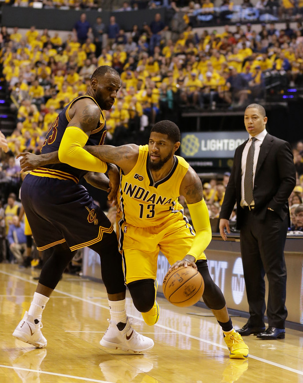 . Indiana Pacers\' Paul George tries to drive past Cleveland Cavaliers\' LeBron James during the second half in Game 3 of a first-round NBA basketball playoff series, Thursday, April 20, 2017, in Indianapolis. (AP Photo/Michael Conroy)