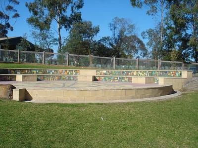 block work amphitheatre with inlaid children's artworks
