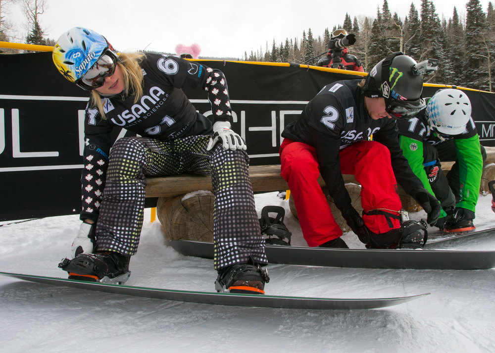 . In this image provided by Nathan Bilow Photography, Canada\'s Dominique Maltais, left, buckles her boot before the women\'s snowboard cross World Cup team event in Telluride, Colo., Saturday, Dec. 15, 2012. Maltais and teammate Maelle Ricker placed first in  Saturday\'s race. (AP Photo/Nathan Bilow)