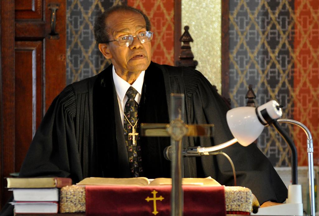 . Rev. Willard Durant leads a memorial service for murder victim David Glasser at Price Memorial AME Zion Church in Pittsfield, Mon Nov 28, 2011 (GARVER)