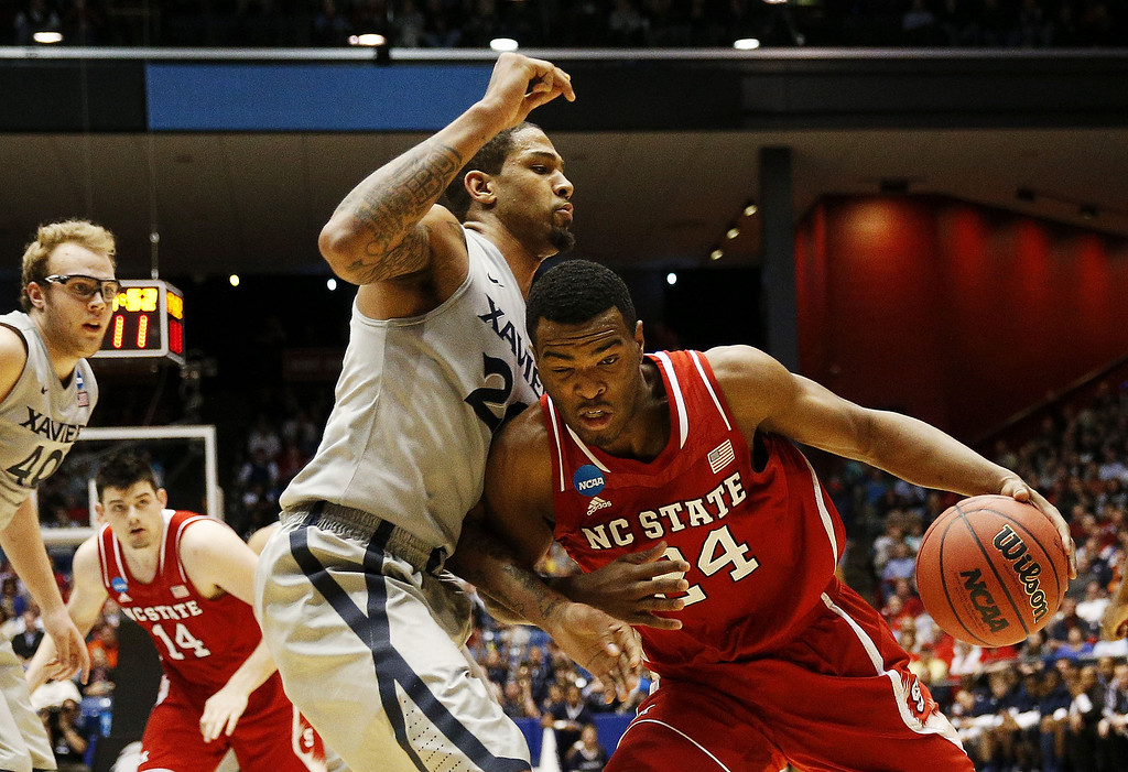 . T.J. Warren #24 of the North Carolina State Wolfpack drives against Justin Martin #20 of the Xavier Musketeers in the second half during the first round of the 2014 NCAA Men\'s Basketball Tournament at at University of Dayton Arena on March 18, 2014 in Dayton, Ohio.  (Photo by Gregory Shamus/Getty Images)