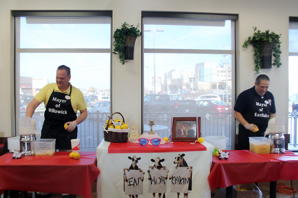 . Kristi Garabrandt � The News-Herald <br> Willowick Mayor Rich Regovich and Eastlake Mayor Dennis Morley  battle it out in the first annual lemon squeeze competition at Chick-Fil-A Willoughby to raise funds for The Miracle League on March 30, 2017.