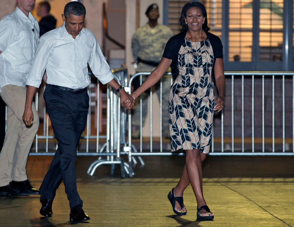 . President Barack Obama and first lady Michelle Obama walk across the tarmac to board Air Force One at Honolulu Joint Base Pearl Harbor-Hickam, Saturday, Jan. 5, 2013, in Honolulu, en route to Washington after their holiday vacation.  (AP Photo/Carolyn Kaster)