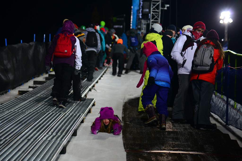 . Cate Borchers, 6, of Basalt slides down the snow walkway on the pipe at the women\'s ski superpipe final in Aspen at Winter X Games in Aspen, January 24, 2014. (Photo By Mahala Gaylord/The Denver Post)