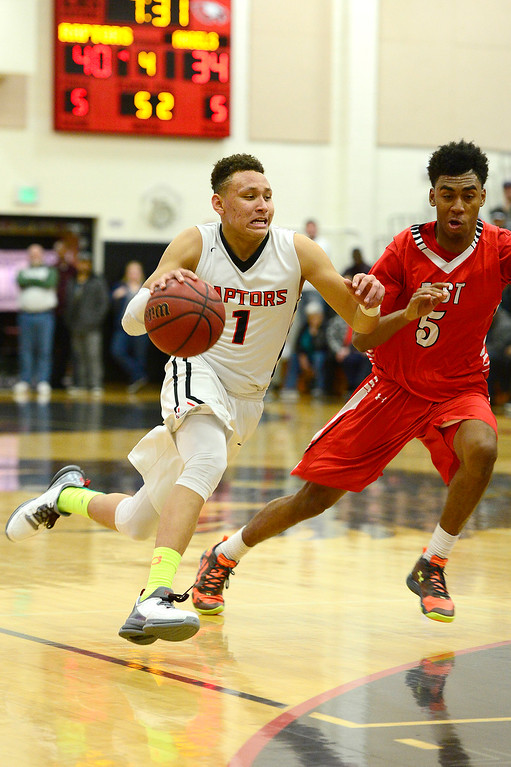 . CENTENNIAL, CO - MARCH 2: Colbey Ross (1) of Eaglecrest moves down court while being defended by Deron Harrell of Denver East during the fourth quarter at Eaglecrest High School on March 2, 2016 in Centennial, Colorado. Eaglecrest defeated Denver East 56-46. (Photo by Brent Lewis/The Denver Post)