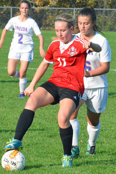 KYLE MENNIG - ONEIDA DAILY DISPATCH Vernon-Verona-Sherrill's Marriah Doig (11) traps the ball near the sideline as Oneida's Kayla Suppa (16) moves in to defend during their Section III Class B playoff match in Oneida on Tuesday, Oct. 18, 2016.