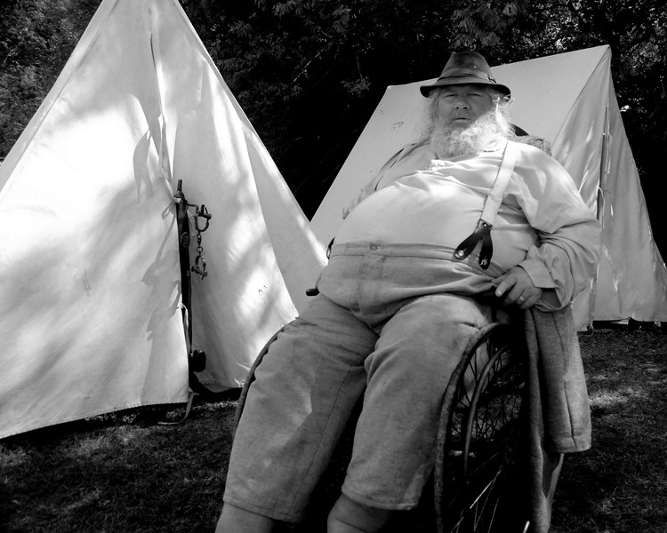 """Reenactor H.G. """"Garfield"""", portraying a provost, sits on the outskirts of the camp at Patriots Point, where a small group of Confederate reenactors set up camp, in Mt. Pleasant, South Carolina on Wednesday, April 13, 2011. ..The 150th Anniversary of the Firing on Ft. Sumter was commemorated with lectures, performances, demonstrations, and a living history throughout the area on James Island, Charleston, Mt. Pleasant, and Sullivan's Island during the week from April 8-14, 2011. Photo Copyright 2011 Jason Barnette"""