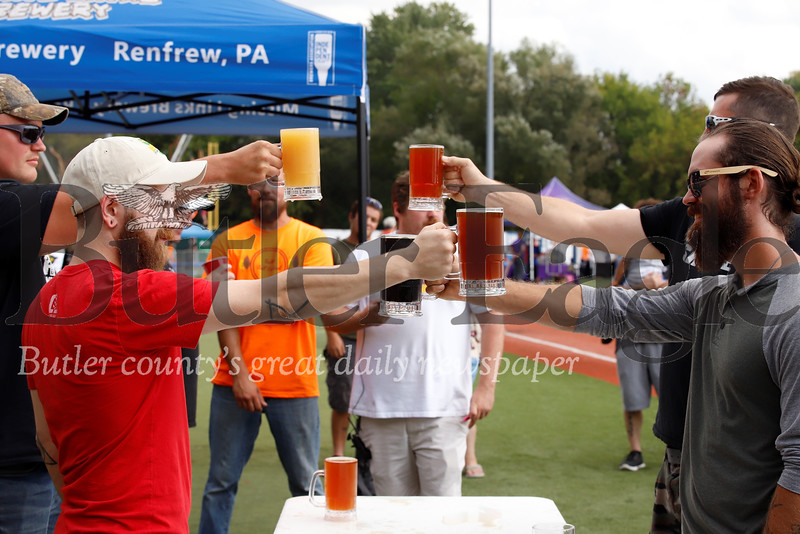 Competitors square off in a stein hoisting competition hosted by Missing Link Brewery at Saturday's Fall Fest at Michelle Krill Field at Pullman Park. The person able to hold up a full beer stein with arm extended won. Seb Foltz/Butler Eagle