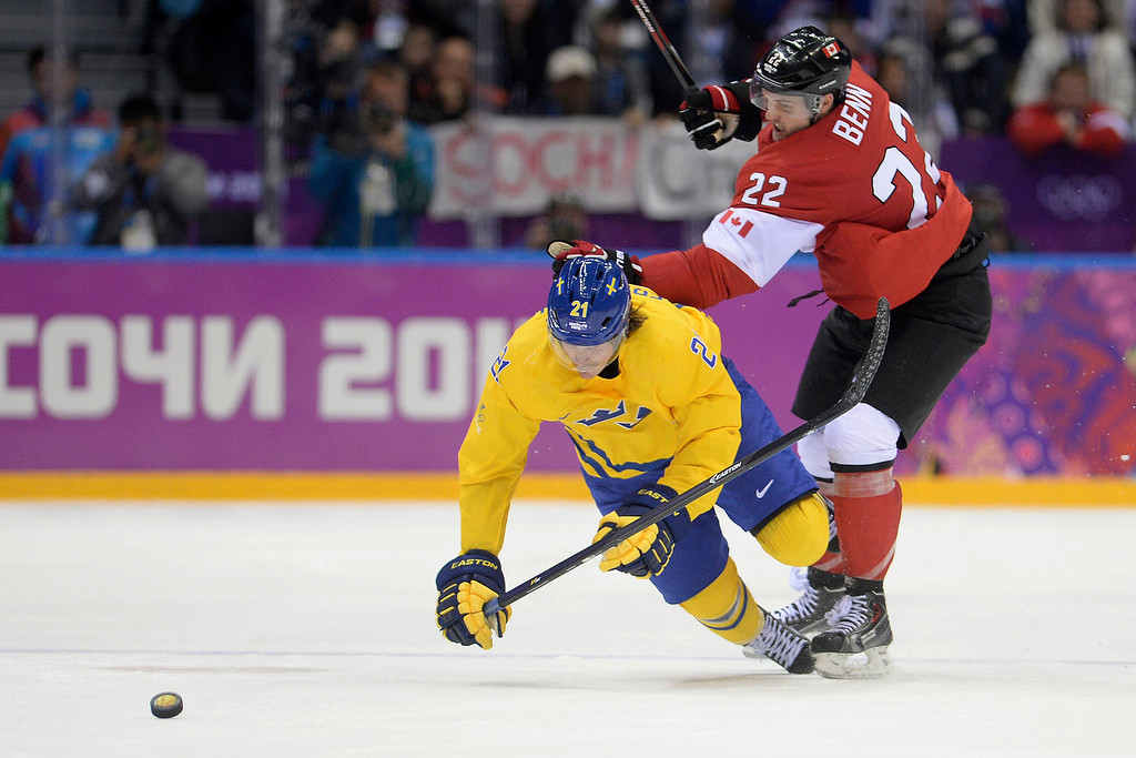 . Jamie Benn (22) of Canada pushes Loui Eriksson (21) of Sweden to the ice during the third period of Canada\'s 3-0 win in the men\'s ice hockey gold medal game against Sweden. Sochi 2014 Winter Olympics on Sunday, February 23, 2014 at Bolshoy Ice Arena. (Photo by AAron Ontiveroz/ The Denver Post)