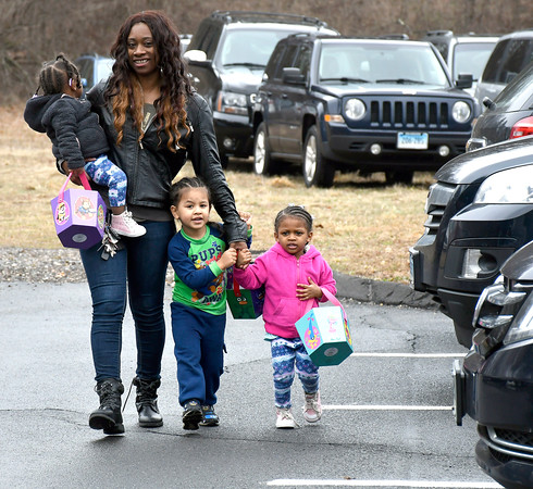 3/30/2018 Mike Orazzi | Staff Jashala Sands and her children Nevaeh Hammer, 1 1/2; Alexander Cruz,4 and Jalexie Hammer,3 while on their way to see the Easter bunny during the Barnes Memorial Nature Center's candy-free Egg Hunt Friday in Bristol.