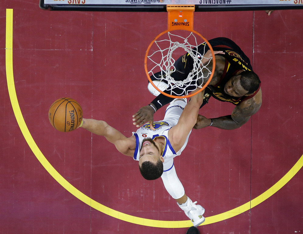 . Golden State Warriors\' Stephen Curry shoots against Cleveland Cavaliers\' LeBron James during the second half of Game 4 of basketball\'s NBA Finals, Friday, June 8, 2018, in Cleveland. (AP Photo/Carlos Osorio, Pool)