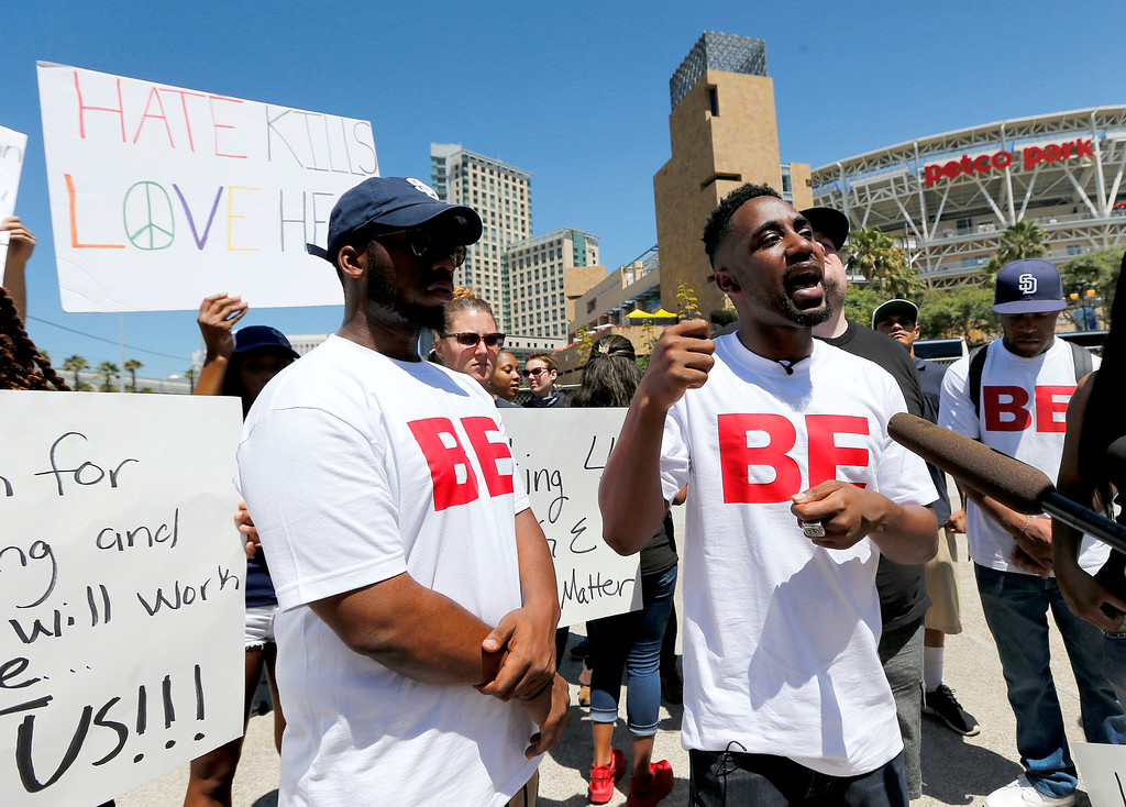 . Black Lives Matter protester Nate Howard speaks outside Petco Park prior to the All-Star Futures baseball game, Sunday, July 10, 2016, in San Diego. (AP Photo/Lenny Ignelzi)