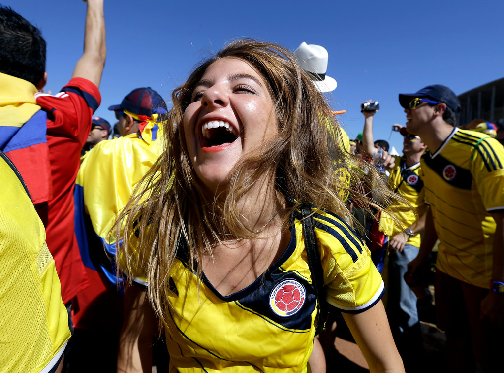 . A Colombian supporter reacts before the start of the group C World Cup soccer match between Colombia and Ivory Coast at the Estadio Nacional in Brasilia, Brazil, Thursday, June 19, 2014. (AP Photo/Sergei Grits)