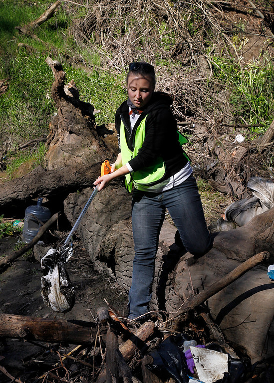 . Dayna Zimmermann from Save Our Shores participates in a clean-up of Coyote Creek near the Highway 280 overpass and Selma Olinder Park, in San Jose, Calif. on Saturday, Feb. 9, 2013.   (LiPo Ching/Staff)