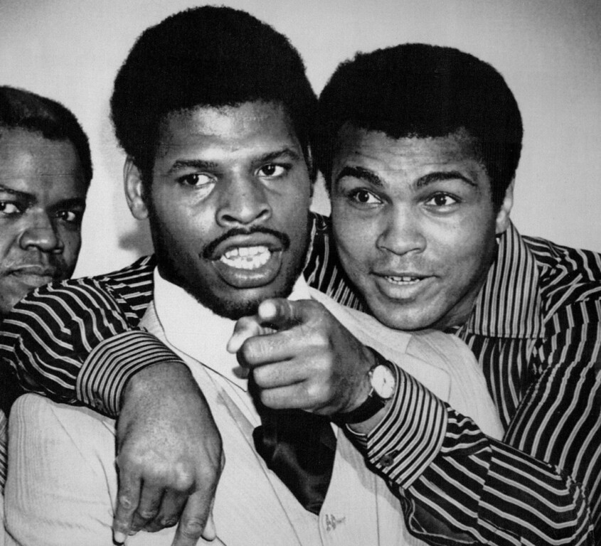. Embracing The Champ -- Muhammad Ali embraces heavyweight champion Leon Spinks during a news conference in New Orleans where they signed to fight Sept. 15, in the Superdome. Ali was giving the champion a few pointers on dealing with the press. 1978. Credit: AP Laserphoto