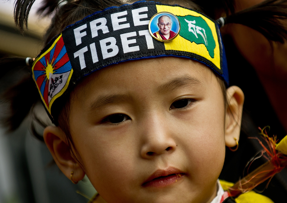 Description of . A Tibetan child is pictured with a Free Tiet bandana as Tibetan activists in-exile take part in a protest in New Delhi on December 10, 2012 to mark World Human Rights Day. A 16-year-old Tibetan girl has died after setting herself on fire, Chinese state media said December 10, in an area that has become a flashpoint for protests against Beijing's rule.  MANAN VATSYAYANA/AFP/Getty Images