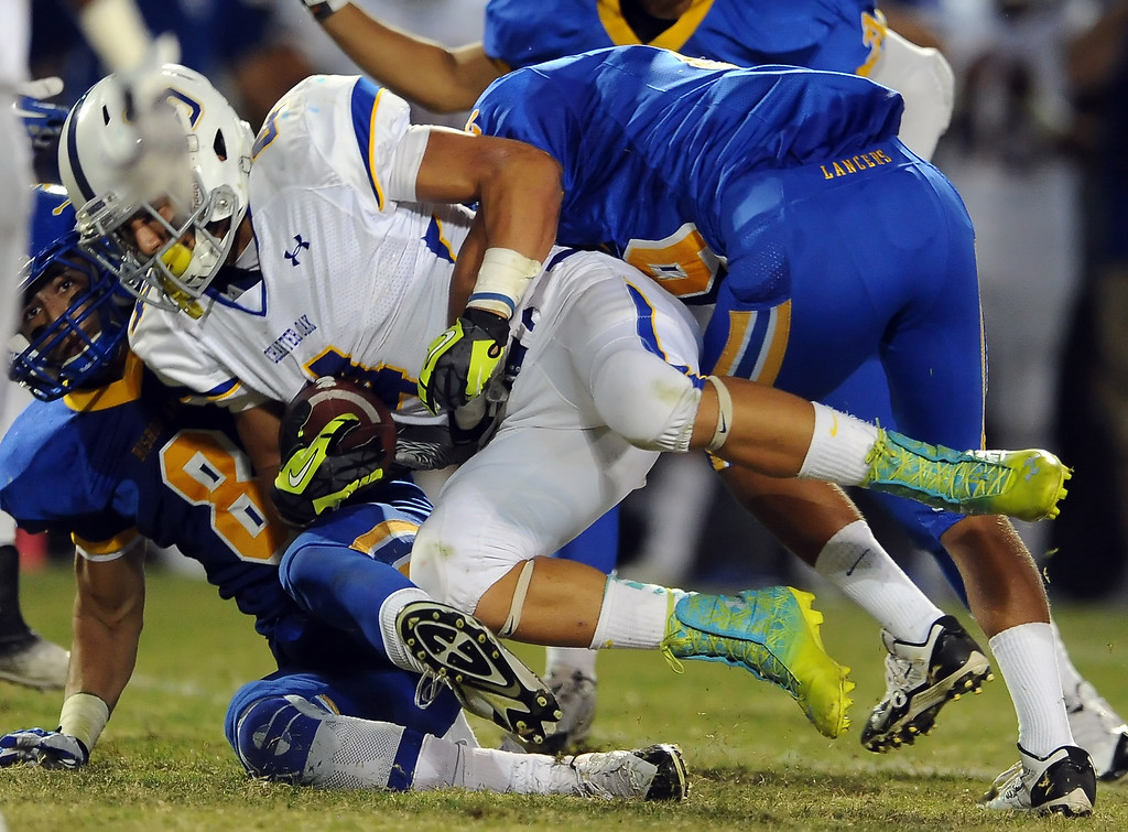 . Bishop Amat defense tackles Charter Oak\'s Donavin Washington (4) in the first half of a prep football game at Bishop Amat High School in La Puente, Calif. on Friday, Sept. 20, 2013.    (Photo by Keith Birmingham/Pasadena Star-News)