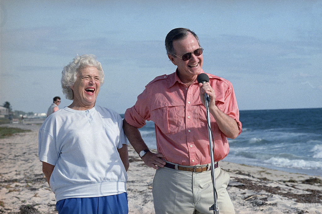. President-elect George Bush and his wife Barbara are shown during a morning beachfront news conference in Gulf Stream, Fla., Nov. 14, 1988. Bush is expected to return to Washington Tuesday after a long weekend vacationing in Florida. (AP Photo/Kathy Willens)