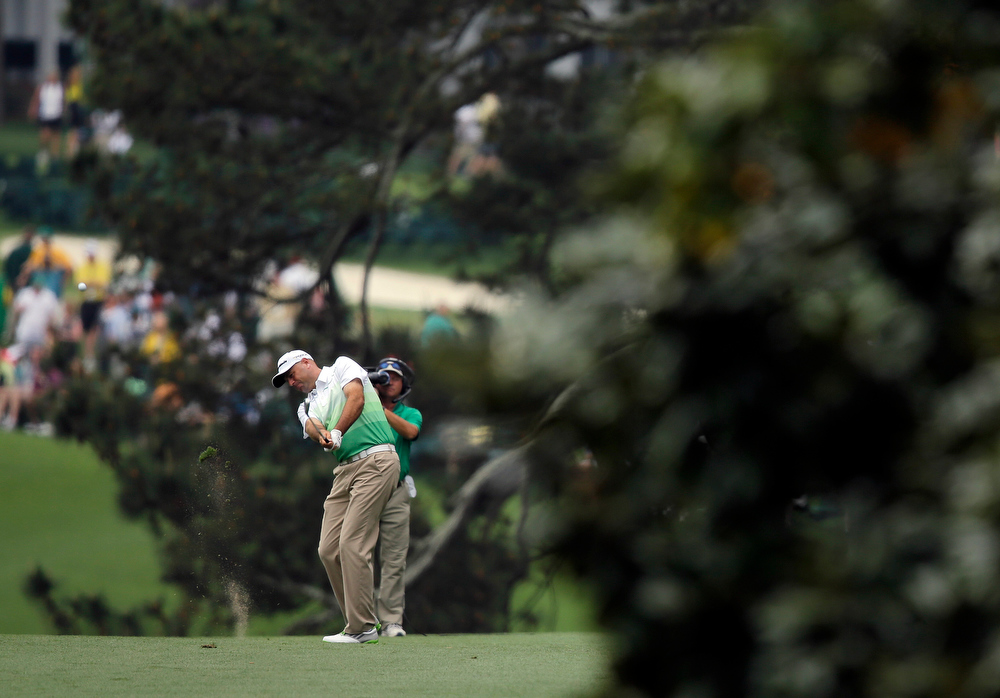 Description of . Stewart Cink hits off the first fairway during the first round of the Masters golf tournament Thursday, April 11, 2013, in Augusta, Ga. (AP Photo/Matt Slocum)