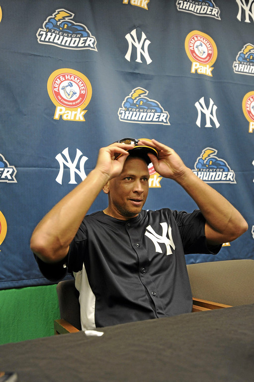 . New York Yankees third baseman Alex Rodriguez fields media questions during a news conference prior to a Class AA baseball game with the Trenton Thunder against the Reading Phillies, Monday, July 15, 2013, in Reading, Pa. Rodriguez is doing a rehab assignment with the Thunder recuperating from hip surgery. (AP Photo/Bradley C Bower)