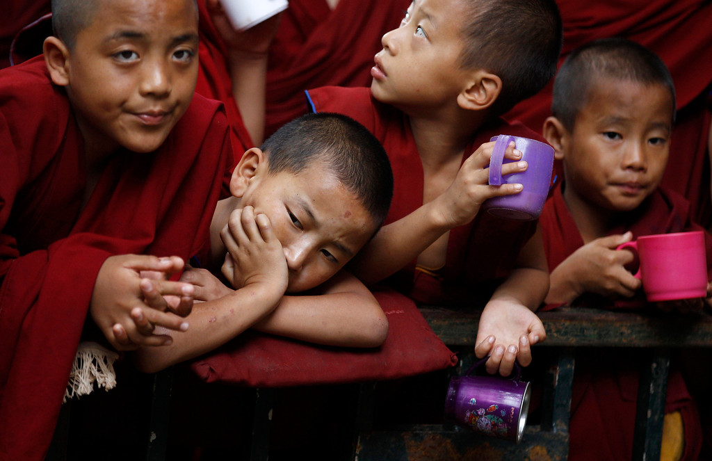 ". Young Tibetan Buddhist monks listen to a speaker during an event organized to celebrate their spiritual leader the Dalai Lama\'s 78th birthday at a Tibetan Buddhist monastery in Bylakuppe, about 220 kilometers (137 miles) southwest of Bangalore , India, Saturday, July 6, 2013. Speaking after an interfaith meeting, he said 150,000 Tibetans living abroad represent ""6 million Tibetans (in China) who have no freedom or opportunity to express what they feel.\"" (AP Photo/Aijaz Rahi)"