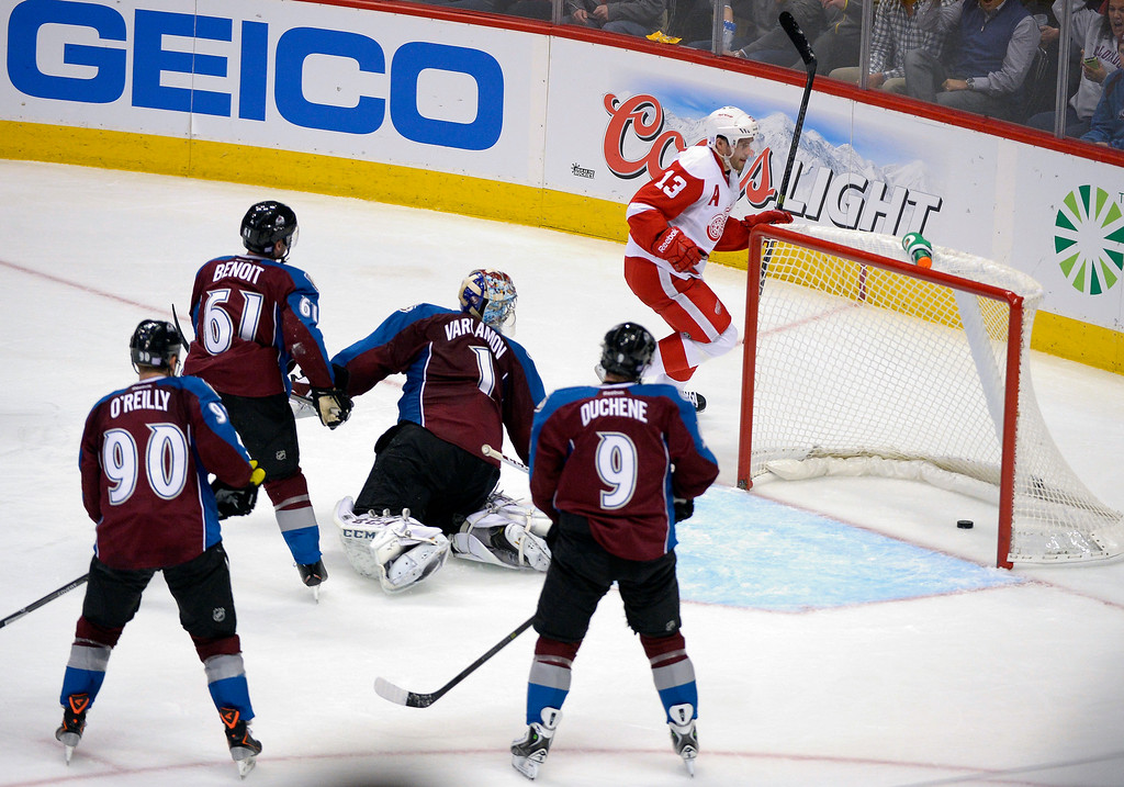 . Detroit Red Wings center Pavel Datsyuk (13) finds the back of the net as he scores on Colorado Avalanche goalie Semyon Varlamov (1) in the third period October 17, 2013 at Pepsi Center. The Detroit Red Wings defeated the Colorado Avalanche 4-2. (Photo by John Leyba/The Denver Post)