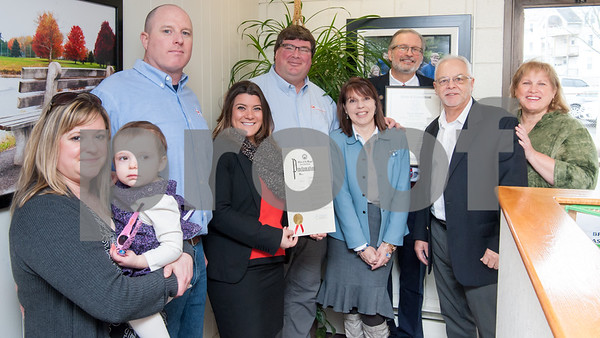 02/20/18 Wesley Bunnell   Staff Collier Electric Corp celebrated 25 years in business with presentations on Tuesday morning by Mayor Erin Stewart and Representative William Petit Jr. Marlo Lagosz, L, holds daughter Addalyn while standing next to finance Bryson Burse who is Vice President and Secretary, Mayor Erin Stewart, President Scott Pehmoeller, Administrative Assistant and Safety Officer Stacey Rich, Representative William Petit Jr., Economic Development Director Bill Carroll and Treasurer Donna Pehmoeller.