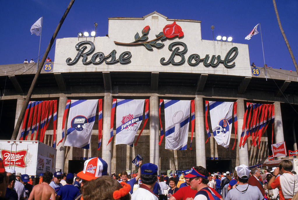 . Team flags hang at the front entrance view of the Rose Bowl as fans enter the stadium for Super Bowl XXI between the New York Giants and the Denver Broncos at the Rose Bowl on January 25, 1987 in Pasadena, California.  The Giants won 39-20.  (Photo by George Rose/Getty Images)