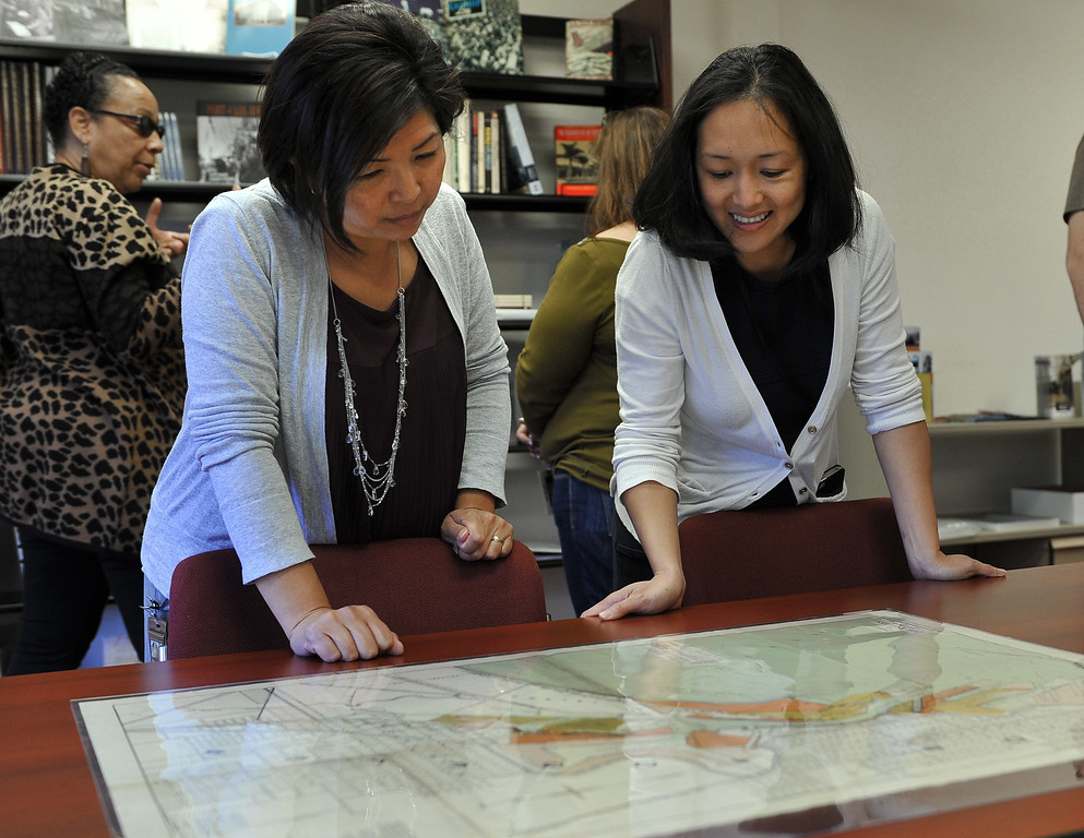 . 4/11/13 - L-R Christina Sar and Geraldine Shimabukuro look over a map as they tour the new office in Wilmington, housing the priceless history of the port and harbor area. The facility will be open by appointment only and able to help with research. Geraldine Knatz, Port Executive Director, is a history buff and has been the driving force behind the archive project. Photo by Brittany Murray / Staff Photographer