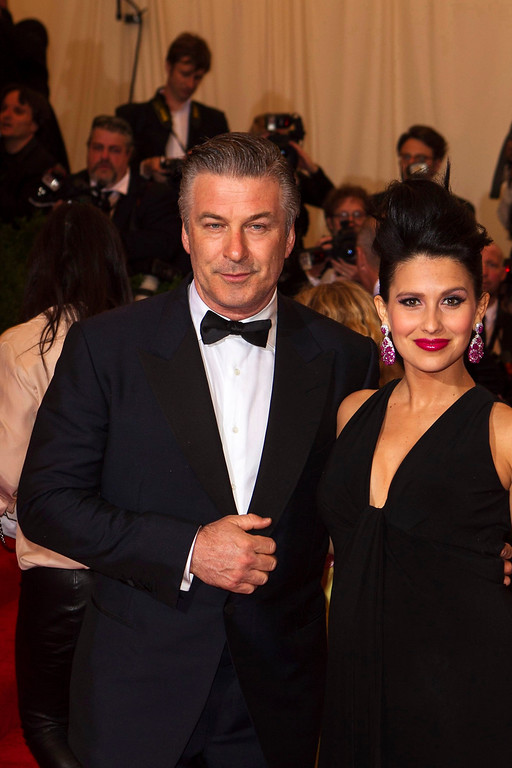 """. Actor Alec Baldwin arrives with wife Hilaria Thomas at the Metropolitan Museum of Art Costume Institute Benefit celebrating the opening of \""""PUNK: Chaos to Couture\"""" in New York, May 6, 2013. REUTERS/Lucas Jackson"""