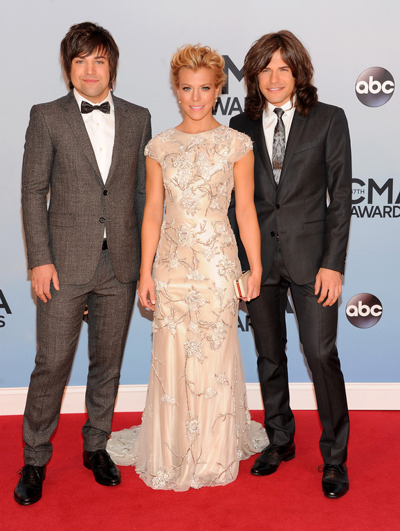 . The Band Perry, from left, Neil, Kimberly and Reid Perry arrive at the 47th annual CMA Awards at Bridgestone Arena on Wednesday, Nov. 6, 2013, in Nashville, Tenn. (Photo by Evan Agostini/Invision/AP)