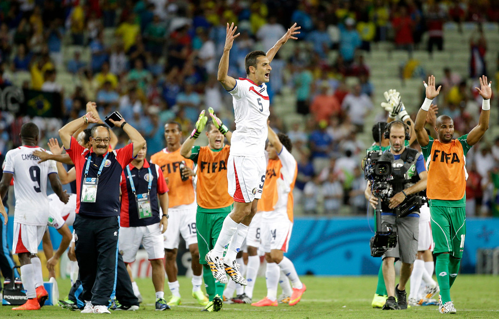 . Costa Rica\'s Celso Borges celebrates after the group D World Cup soccer match between Uruguay and Costa Rica at the Arena Castelao in Fortaleza, Brazil, Saturday, June 14, 2014.  Costa Rica won the match 3-1. (AP Photo/Christophe Ena)