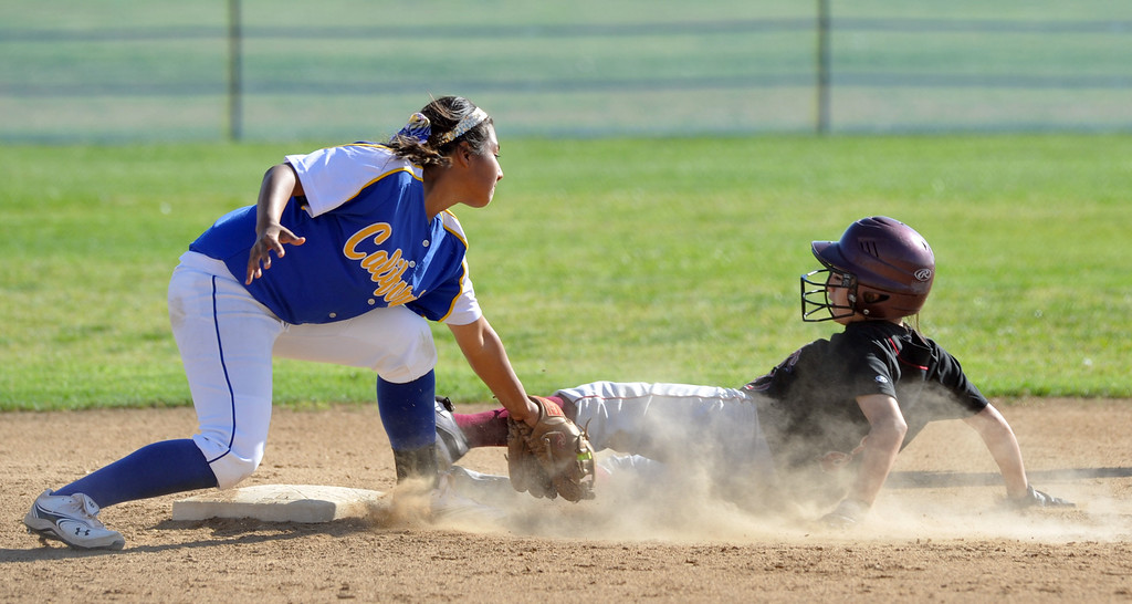 . California shortstop Joslyn Macias (#26) tags out Bell Gardens\' Denise Rodarte (#31) in their non-league game at California High School in Whittier on Thursday March 14, 2013. California beat Bell Gardens 11-0 in five innings. (SGVN/Staff Photo by Keith Durflinger)