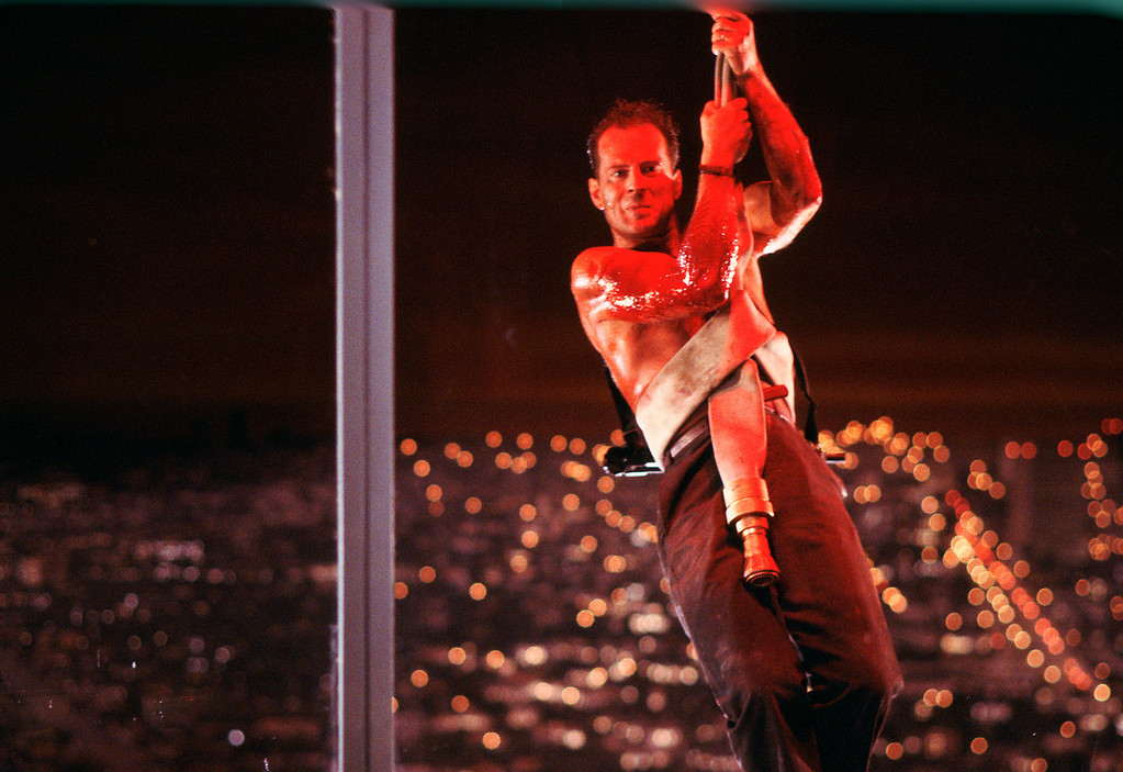 . This publicity photo released by Twentieth Century Fox Home Entertainment shows Bruce Willis in a scene from the 1988 film,  (AP Photo/Twentieth Century Fox Home Entertainment)