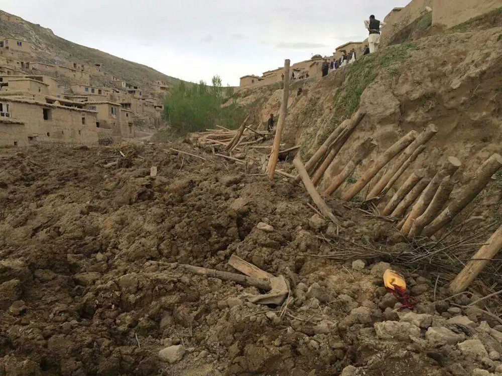 . In this photo provided by Homayoon Rahmani, the chief of road reconstruction program in the Afghan Rural and Rehabilitation Development Ministry,Afghans search for survivors after a massive landslide landslide buried a village Friday, May 2, 2014 in Badakhshan province, northeastern Afghanistan, which Afghan and U.N. officials say left hundreds of dead and missing missing.(AP Photo/Homayoon Rahmani)